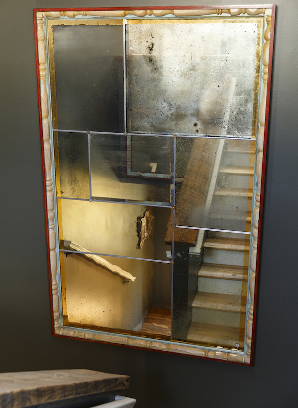 stunning mirror in back stairwell created by Bob Hines of Hines Studios